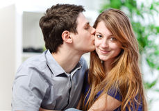 Handsome young man embracing his girlfriend with love Stock Image