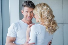 Handsome young man embracing his wife Stock Images