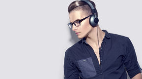 Handsome young man enjoying music on headphones Royalty Free Stock Image