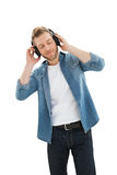 Handsome young man enjoying music Stock Images