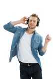 Handsome of a young man enjoying music Stock Image