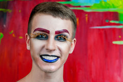 Handsome young man fashion model with make-up Royalty Free Stock Images