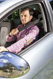 Handsome young man fastening seat belt Royalty Free Stock Image