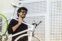 Handsome young man with fixed gear bicycle. Stock Image