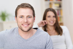 Handsome young man with a friendly smile royalty free stock image