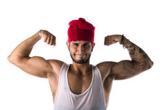 Handsome young man in funny red hat doing silly expression Stock Images
