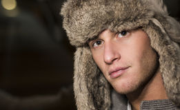 Handsome young man with fur hat Royalty Free Stock Photography