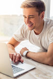 Handsome young man with gadget Royalty Free Stock Image