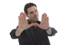 Handsome young man gesturing Royalty Free Stock Images