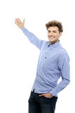 Handsome young man gesturing welcome Stock Images