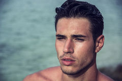 Handsome young man getting out of water with wet hair Royalty Free Stock Photo
