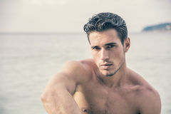 Handsome young man getting out of water with wet hair Royalty Free Stock Photos