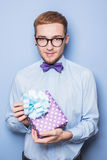 Handsome young man with a gift box. Present, birthday, Valentine Stock Photos