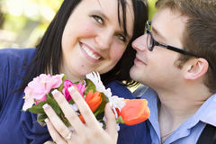 Handsome Young Man Gives Flowers to His Love Royalty Free Stock Photos
