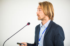 Handsome young man giving a speech Royalty Free Stock Image