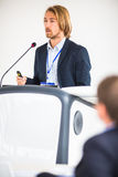 Handsome young man giving a speech Royalty Free Stock Images