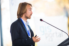 Handsome young man giving a speech Stock Images