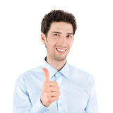 Handsome success young man giving a thumb up Stock Photo