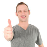 Handsome young man giving a thumbs up Stock Photo
