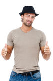 A handsome young man giving you the thumbs up Royalty Free Stock Images