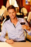 Handsome young man with glass of red wine Royalty Free Stock Photo