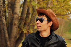 Handsome young man in glasses and a hat. Stock Photo