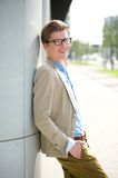 Handsome young man with glasses smiling Royalty Free Stock Images