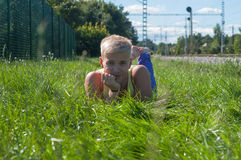 Handsome young man on the grass Royalty Free Stock Image