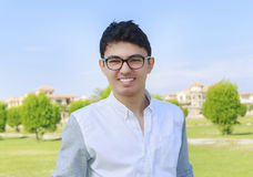 Handsome young man with great smile wearing eye wear. Royalty Free Stock Photography