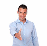 Handsome young man with greeting gesture royalty free stock photography