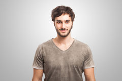Handsome young man on grey background Royalty Free Stock Photo