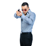 Handsome young man with gun isolated Royalty Free Stock Images