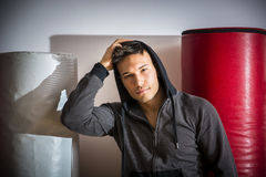 Handsome young man in gym by punching bag Royalty Free Stock Images