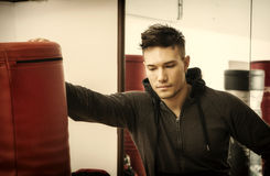 Handsome young man in gym by punching bag Royalty Free Stock Photo