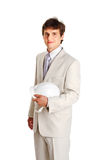 Handsome young man with hardhat on white Royalty Free Stock Photos