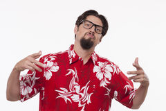 Handsome young man in Hawaiian shirt posing against white backgr Royalty Free Stock Photo