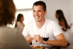 Handsome young man with his girlfriend. Handsome young man enjoying pizza with his girlfriend in a restaurant Royalty Free Stock Image