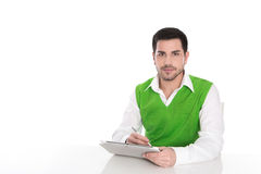 Handsome young man with his notebook isolated on white. Stock Photo