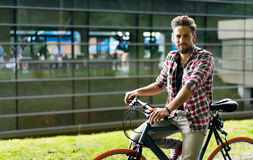 Handsome young man with his retro bike Stock Image
