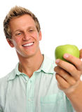 Handsome young man holding an apple Royalty Free Stock Photo