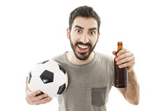 Handsome young man holding ball and beer Royalty Free Stock Image