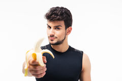 Handsome young man holding banana Royalty Free Stock Image