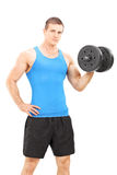 Handsome young man holding a barbell Royalty Free Stock Images