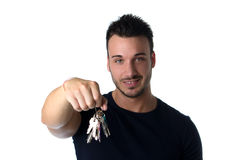 Handsome young man holding bunch of keys Stock Image