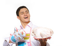 Handsome young man holding chicken ready to cook Royalty Free Stock Photos