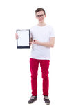 Handsome young man holding clipboard with copy space isolated on Royalty Free Stock Image