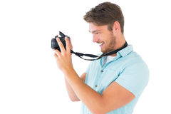 Handsome young man holding digital camera Royalty Free Stock Image
