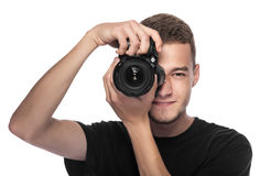 Handsome young man holding a DSLR camera. On white Stock Photo