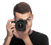 Handsome young man holding a DSLR camera. Stock Images