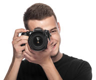 Handsome young man holding a DSLR camera. On white Stock Photos